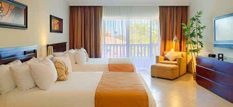 Two beds with orange accent linens